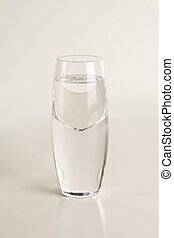 Glass of vodka on light gray background - Beautiful glass of...