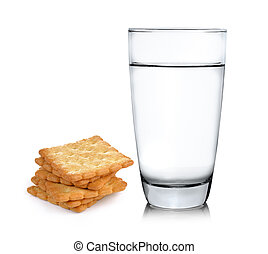 Glass of water and Cracker on white background