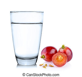 Glass of water and grapes isolated on white background