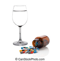 glass of water and pills capsules isolated on white background