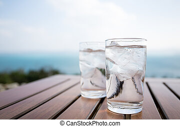Glass of water at outdoor restaurant