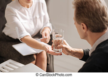 Glass of water being given to the patient
