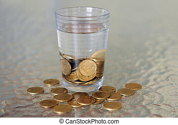 Glass of Water Collecting Falling Coins