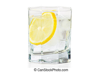 Glass of water, ice and slice of fresh lemon on a white...