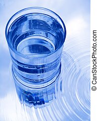 Glass of water in blue