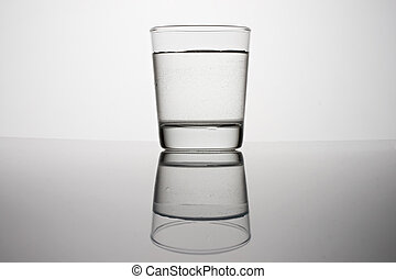 Glass of water on a grey background