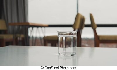 Glass of water on the table