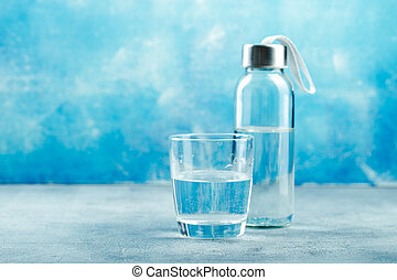 Glass of water with a bottle