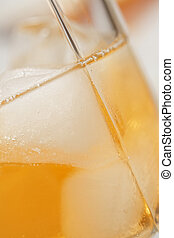 Glass of whiskey closeup