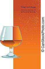 Glass of whiskey on orange background.