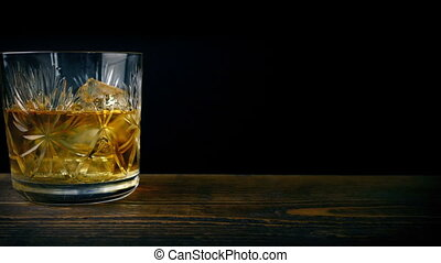 Glass Of Whiskey On Table - Whiskey on the rocks in glass...