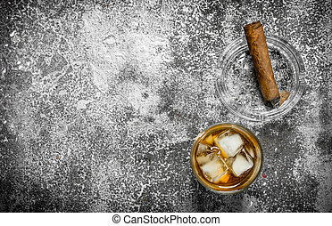 glass of whiskey with a cigar.