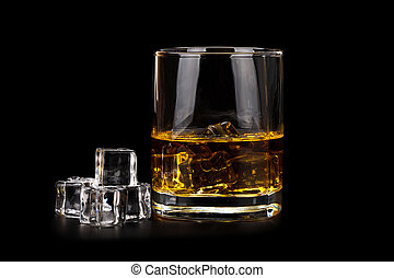 Glass of whiskey with ice cubes isolated on black background