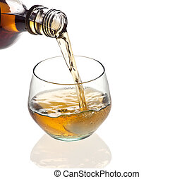 Glass of whisky - A glass of whiskey being poured on a white...