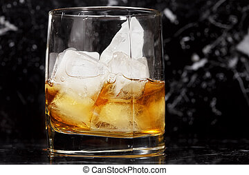 Glass of whisky over dark