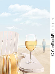 Glass of white wine on chair