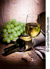 Glass of white wine on wooden background