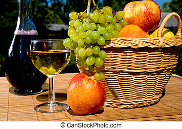 Glass of white wine with fruits
