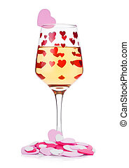 Glass of white wine with red and pink heart shape - Glass of...