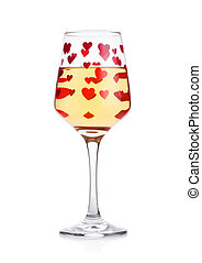 Glass of white wine with red and pink heart shape