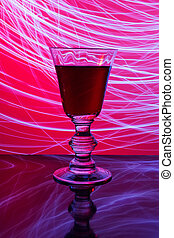 Glass of wine and abstract light
