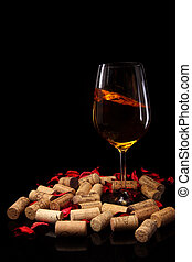 Glass of wine and corks