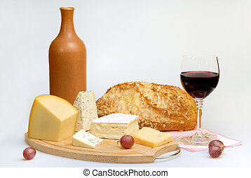 Glass of wine bottle and cheese