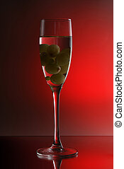 Glass of wine on a red background