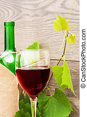 glass of wine on a wooden background