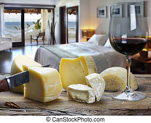 Glass of wine with cheese at the beach hotel room