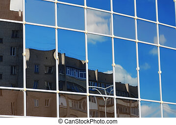glass office building reflection sky cloud