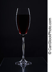 Glass on a black background - Glass with a long leg on a...