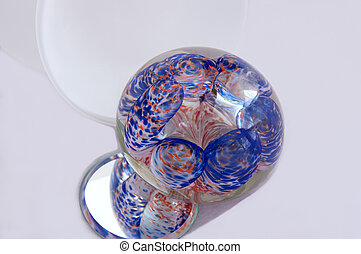 Glass Ornament and Mirror on White Background