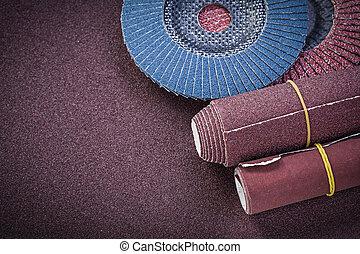 Glass-paper abrasive flap wheels on polishing sheet