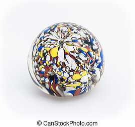 Multicoloured glass paperweight on plain white background