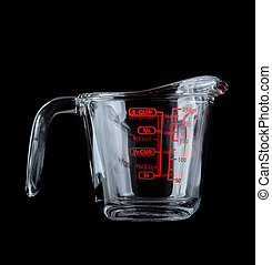 Glass pitcher of water isolated on black