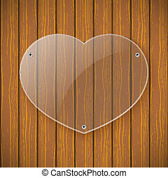 Glass plate in the form of heart on the background of wooden wall