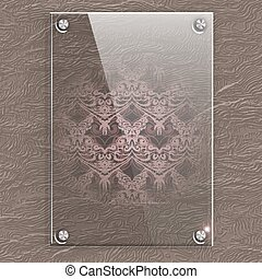 Glass plate on a leather background with translucent Victorian pattern.