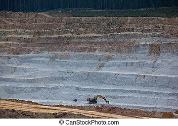 Glass sand quarry - Excavator mining layer of glass sand