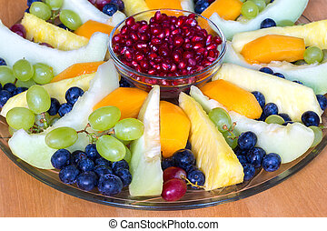 Glass scale full of various fresh fruits