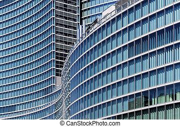 Glass skyscraper in Milan - Detail of a curvilinear building...