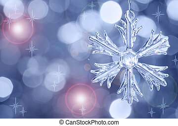 Glass snowflake against blurred background