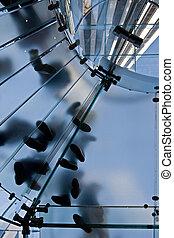 glass stairway - people standing on circular stairway made ...