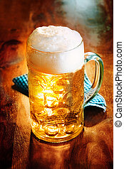 Glass tankard of frothy craft beer