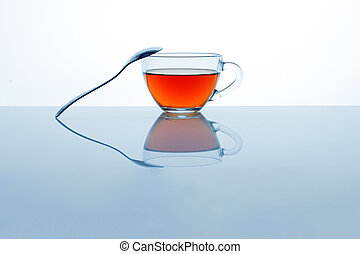 Glass tea cup with spoon.