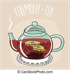 Glass teapot with tea raspberry