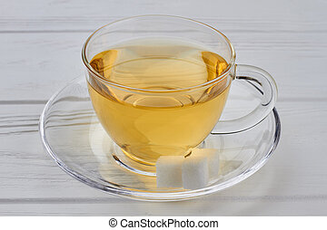 Glass transparent cup with hot tea.