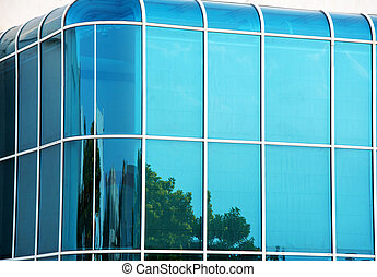 Glass wall of modern building with curved corners