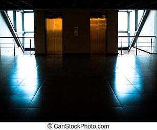 Glass wall with door to elevators in office building