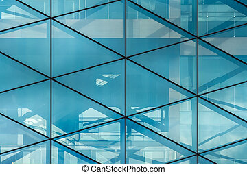 Glass wall with reflections in the office building